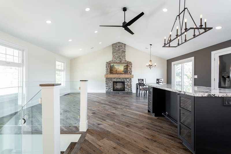 An open concept living room and kitchen with vaulted ceilings at 5469 Walkers Line