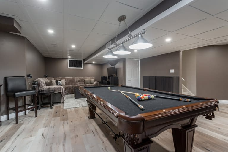 A basement rec room with a pool table at 75 davis street