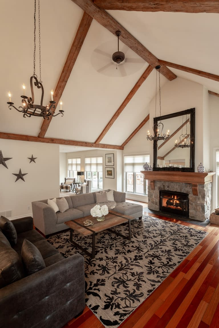 Tall vaulted ceiling in a rustic living room with fireplace and sitting area