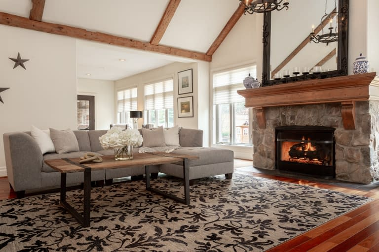 rustic country living room with large fire place and vaulted ceilings