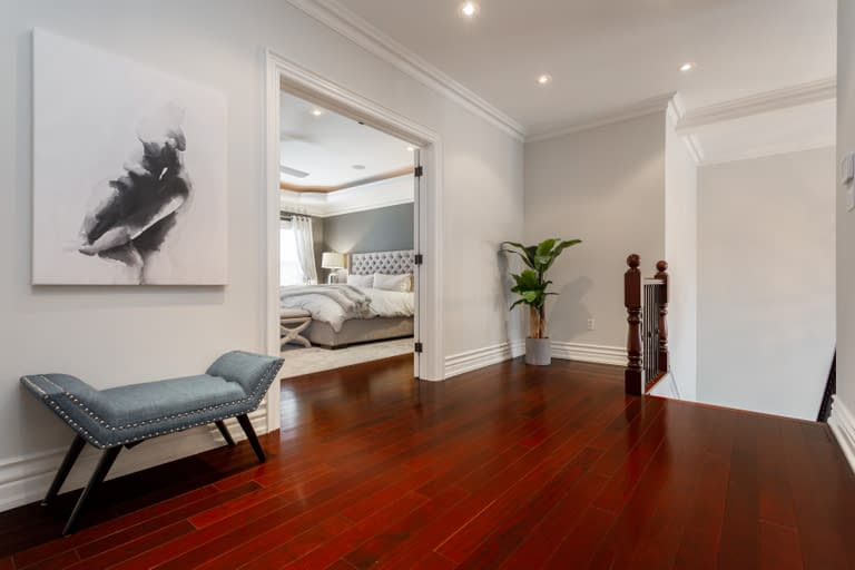 A view into a luxury master bedroom suite for recent listings