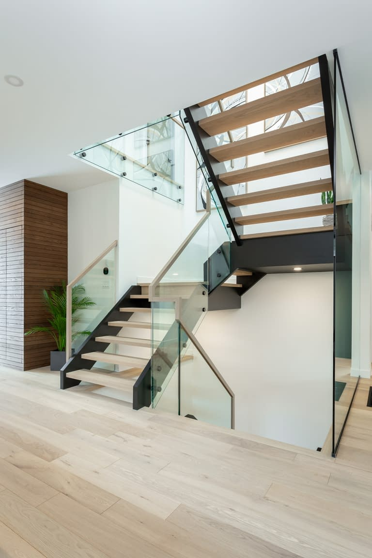 The modern oak and glass staircase at 414 Delaware Avenue