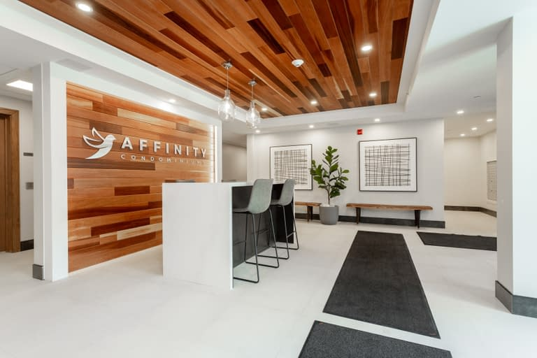 Modern reception area with wood ceilings at 340 Plains Road Burlington