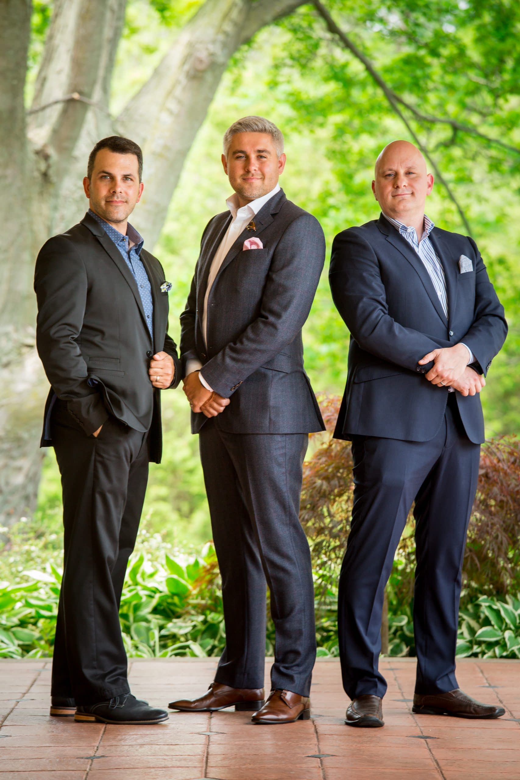 Group Photo of three real estate agents in front of trees and natural environment
